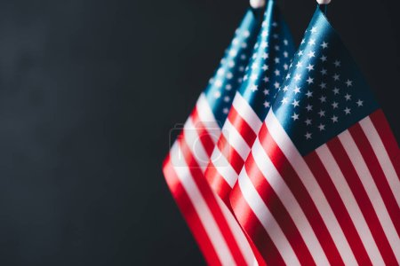 Photo for Selective focus of usa national country flags isolated on black, memorial day concept - Royalty Free Image