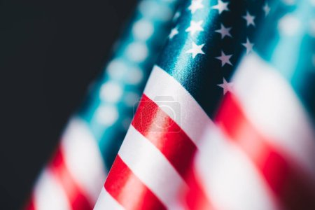 selective focus of united states of america national flags isolated on black, memorial day concept