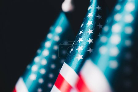 Photo for Selective focus of usa national flags isolated on black, memorial day concept - Royalty Free Image