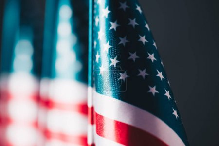 Photo for Selective focus of united states national country flag isolated on black, memorial day concept - Royalty Free Image