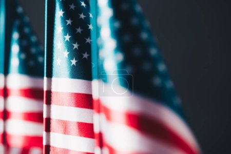 Photo for Selective focus of united states of america national flags isolated on black, memorial day concept - Royalty Free Image