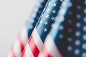 "Постер, картина, фотообои ""selective focus of usa national flags isolated on grey, memorial day concept"""