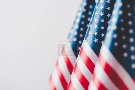 Photo for Selective focus of united states of america national flags isolated on grey, memorial day concept - Royalty Free Image