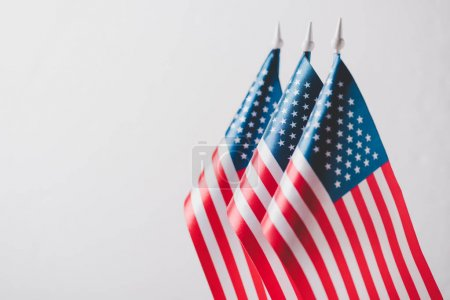 Photo pour United states of america national flags on flagpoles isolated on grey, memorial day concept - image libre de droit