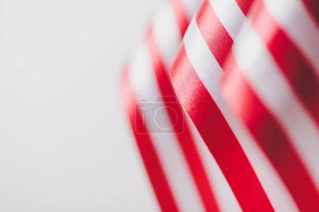 Photo for Stripes of american national flags isolated on grey, memorial day concept - Royalty Free Image