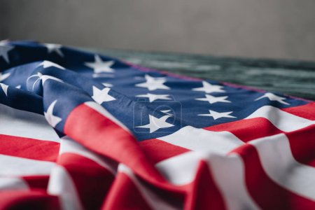 Photo for Folded american flag on grey background, memorial day concept - Royalty Free Image