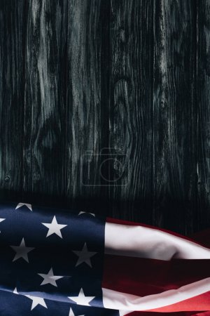 folded usa national flag on grey wooden background, memorial day concept