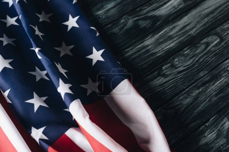 Photo for Folded usa national flag on grey wooden surface, memorial day concept - Royalty Free Image