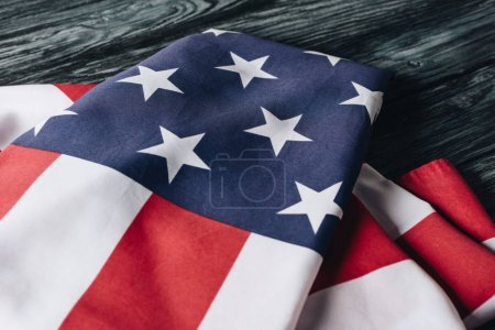 Photo for Folded united states national flag on grey wooden surface, memorial day concept - Royalty Free Image