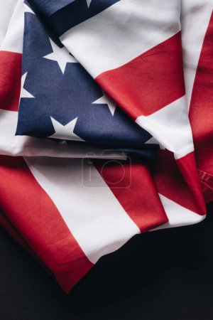 Photo for Folded american national flag isolated on black, memorial day concept - Royalty Free Image