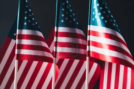 Photo pour National flags of united states of america isolated on black, memorial day concept - image libre de droit