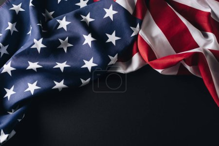Photo for Folded national flag of america isolated on black, memorial day concept - Royalty Free Image