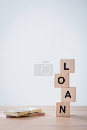 Photo for Word loan made of wooden cubes and cars keys on wooden surface isolated on grey - Royalty Free Image