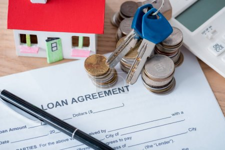Photo for Loan agreement, pen, coins, house model and keys on wooden surface - Royalty Free Image