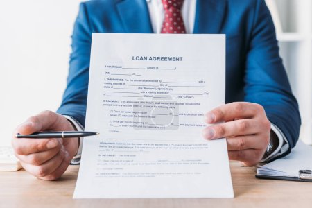 Photo for Partial view of businessman pointing with pen at loan agreement - Royalty Free Image