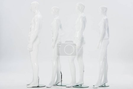 Photo for White plastic mannequins in row on white - Royalty Free Image