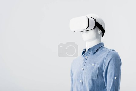 Photo for Plastic mannequin in clothes with Virtual reality headset isolated on grey with copy space - Royalty Free Image