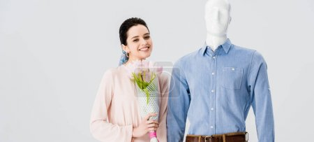 Photo for Panoramic shot of beautiful girl with mannequin and flower bouquet isolated on grey - Royalty Free Image