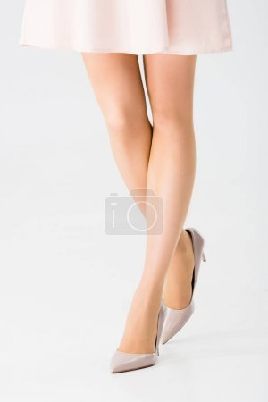 Photo for Cropped view of young woman in stylish shoes isolated on grey - Royalty Free Image