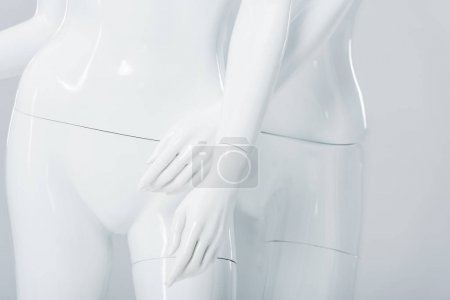 Photo for Close up view of white plastic mannequins isolated on grey - Royalty Free Image
