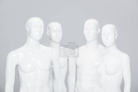 Photo for White plastic mannequin dolls isolated on grey - Royalty Free Image
