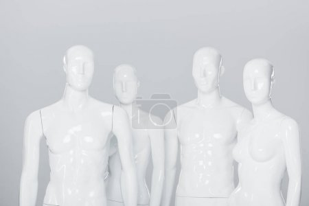 Photo for White plastic mannequin dummies isolated on grey - Royalty Free Image