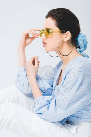 Photo for Beautiful stylish young woman in sunglasses posing isolated on grey - Royalty Free Image