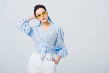 Photo for Beautiful stylish girl in sunglasses posing isolated on grey with copy space - Royalty Free Image