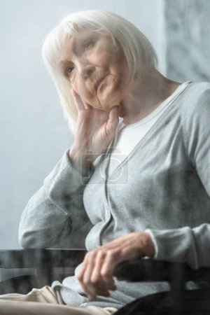 Photo for Selective focus of pensive disabled senior woman with grey hair - Royalty Free Image