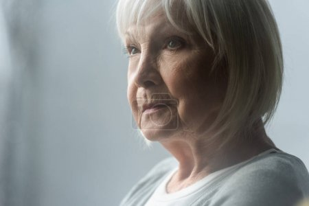 Photo for Pensive senior woman with grey hair looking away - Royalty Free Image