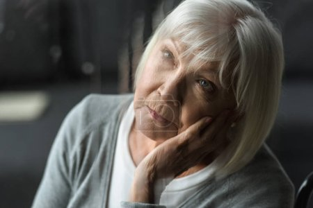 Photo for Selective focus of pensive senior woman with grey hair propping face with hand - Royalty Free Image