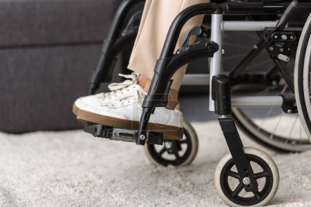Photo for Partial view of disabled senior woman on wheelchair - Royalty Free Image