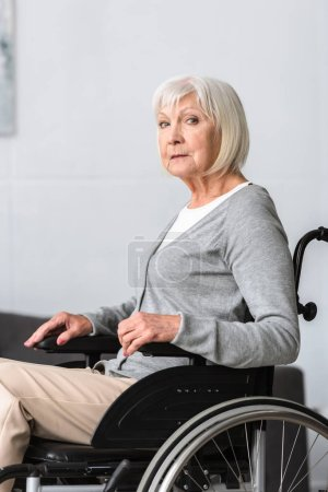 Photo for Disabled senior woman sitting in wheelchair and looking at camera - Royalty Free Image