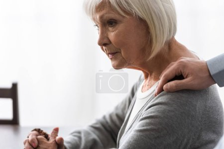 Photo for Partial view of man supporting senior mother with grey hair - Royalty Free Image