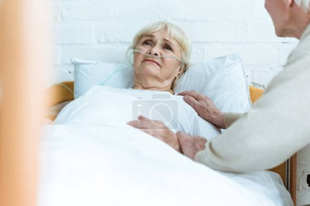 Photo for Partial view of senior man with sick wife in hospital - Royalty Free Image
