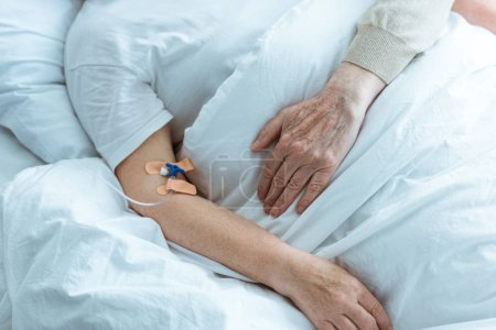 Photo for Partial view of sick senior woman with husband in hospital - Royalty Free Image