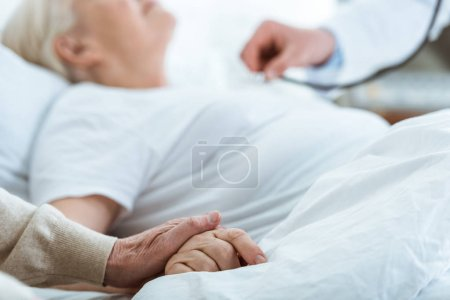 Photo for Partial view of doctor, sick patient and senior man - Royalty Free Image