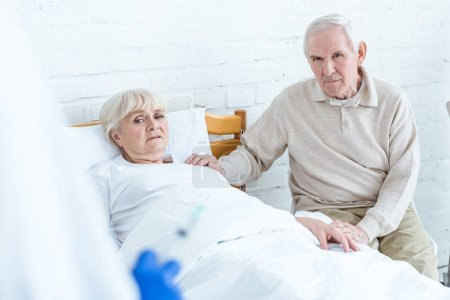 Photo for Worried ill senior woman and her husband in hospital - Royalty Free Image