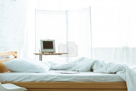 Photo for Empty bed and medical equipment in hospital ward - Royalty Free Image