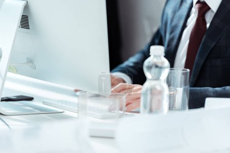 Photo for Cropped view of businessman working in modern office - Royalty Free Image