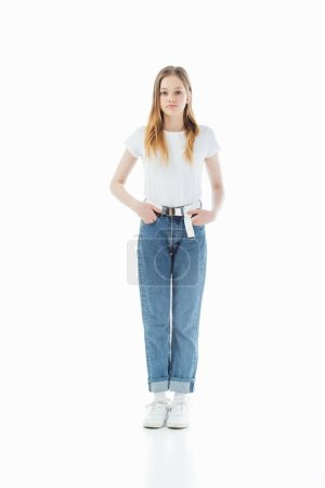 Photo for Full length view of sad teenage girl with hands in pockets isolated on white - Royalty Free Image
