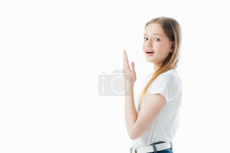 Photo for Happy teenage girl with raised hand looking at camera isolated on white - Royalty Free Image