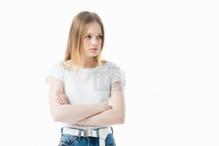 Photo for Upset and offended teenage girl with crossed arms isolated on white - Royalty Free Image