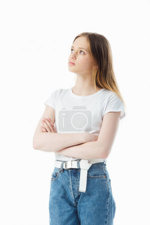 Photo for Upset and offended teenage girl with crossed arms looking away isolated on white - Royalty Free Image