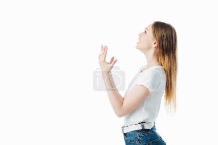 Photo pour Vue latérale d'adolescente irritée gesticulant isolé sur blanc - image libre de droit