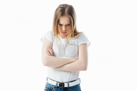 Photo for Offended teenage girl with crossed arms looking away isolated on white - Royalty Free Image