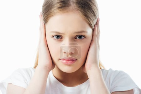 Photo for Offended teenage girl covering ears with hands isolated on white - Royalty Free Image