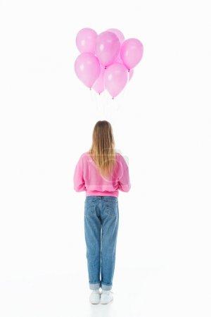 Photo pour Vue arrière de l'adolescente avec des ballons roses isolés sur le blanc - image libre de droit