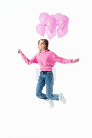 Foto de Chica adolescente feliz con globos rosas saltando aislado en blanco - Imagen libre de derechos