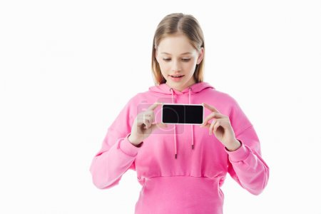 Photo for Teenage girl in pink hoodie holding smartphone with blank screen isolated on white - Royalty Free Image